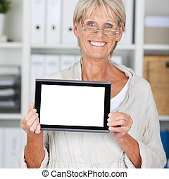 Senior Businesswoman Displaying Digital Tablet In Office