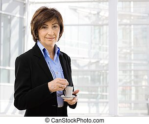 Senior businesswoman drinking coffe