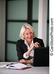 Senior businesswoman laughing