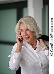 Senior businesswoman on the phone
