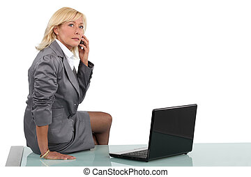 Senior businesswoman sitting on her desk