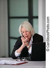 senior businesswoman working at her desk