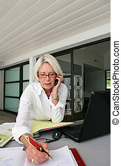 senior businesswoman working at home