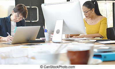 Senior businesswomen working together in the office