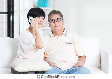 Senior calling on smart phone