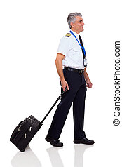 senior captain walking with briefcase