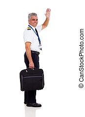 senior captain waving goodbye