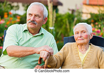 Senior Care - Elderly woman with her son in the residential...
