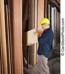 Senior Carpenter Arranging Planks