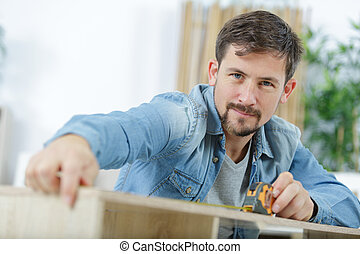senior carpenter building a bed