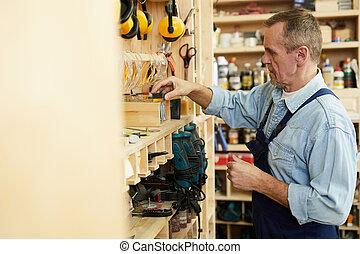 Senior Carpenter Choosing Tools