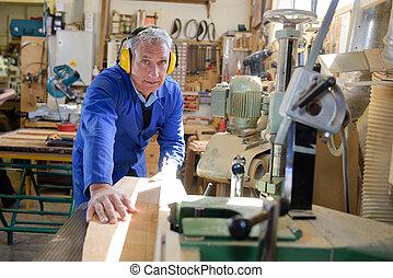 Senior carpenter in workshop