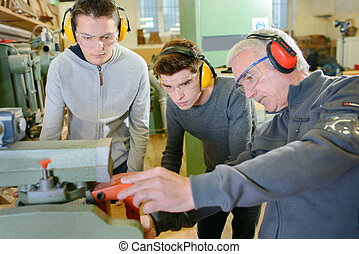 Senior carpenter with two learners
