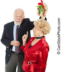 Senior Casanova with Mistletoe - Senior man chasing a ...