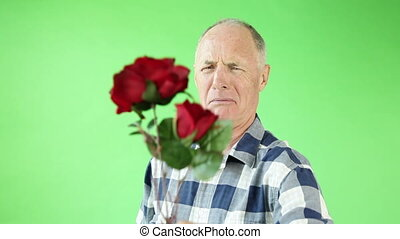 Senior casual caucasian man isolated green screen upset with roses