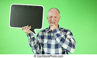 Senior casual caucasian man isolated green screen upset with blank sign