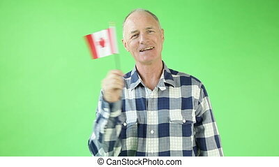 Senior casual caucasian man isolated green screen with canadian flag