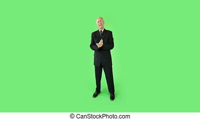 Senior caucasian business man green screen confident...