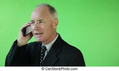 Senior caucasian business man green screen confident on the phone