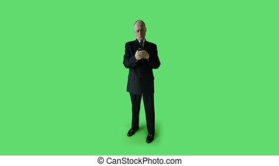 Senior caucasian business man green screen confidetn with phone