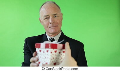 Senior caucasian business man green screen receiving gift