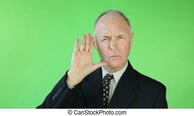 Senior caucasian business man green screen stop hand gesture