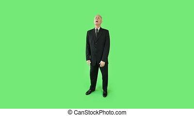 Senior caucasian business man green screen upset interview