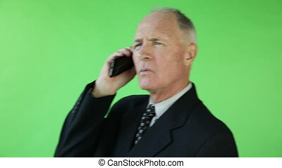 Senior caucasian business man green screen upset on the phone