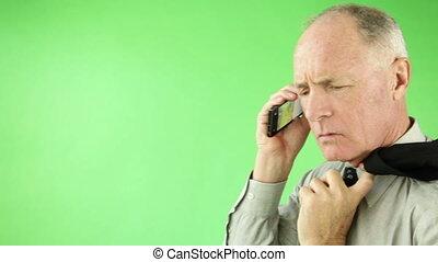 Senior caucasian business man green screen upset with phone
