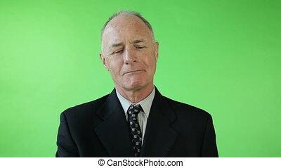 Senior caucasian business man green screen upset with roses