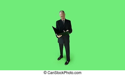 Senior caucasian business man green screen upset with binder...