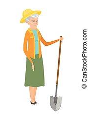 Senior caucasian farmer holding a shovel.