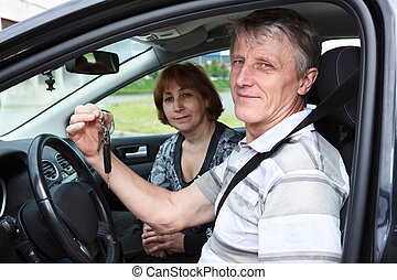 Senior Caucasian male and woman sitting in land vehicle and ...