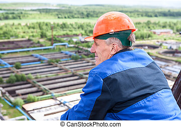 Senior Caucasian man a manual worker at the industrial plant