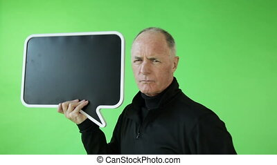 Senior caucasian sport man green screen upset with blank sign