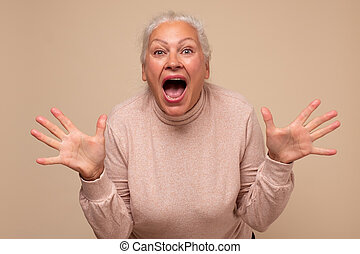 Senior caucasian woman is happy and shows ten fingers