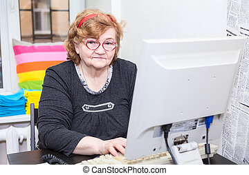 Senior Caucasian woman working with computer