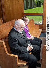 Senior Caucuasian Man Young Woman Bowed Heads Praying Church Pew