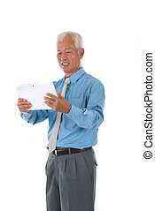 senior chinese singaporean with a tablet business man isolated on white background