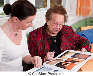 Senior citizen in this gallery scrolls - An old woman leafs ...