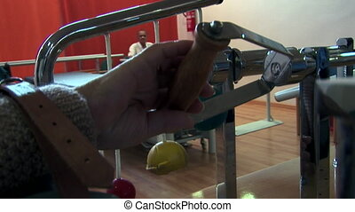 Senior citizen rehabilitating hand with machine