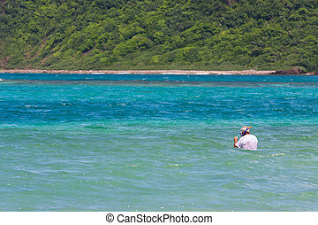 Senior Citizen Snorkeling in Tropical Waters