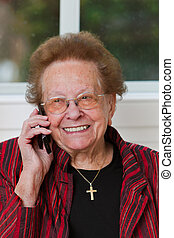 Senior citizen with a mobile phone call leads
