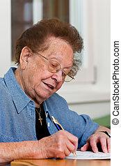 Senior citizen writes a letter