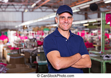 senior clothing factory owner portrait - portrait of happy...