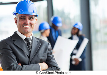 senior construction manager with arms crossed