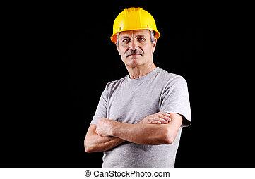 Senior constructor - Senior constructor on black background...