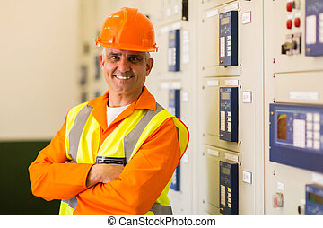 senior control room engineer with arms crossed