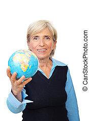 Senior corporate woman hold a globe