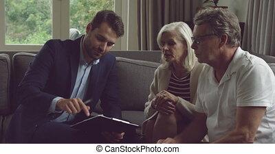 Senior couple and financial advisor